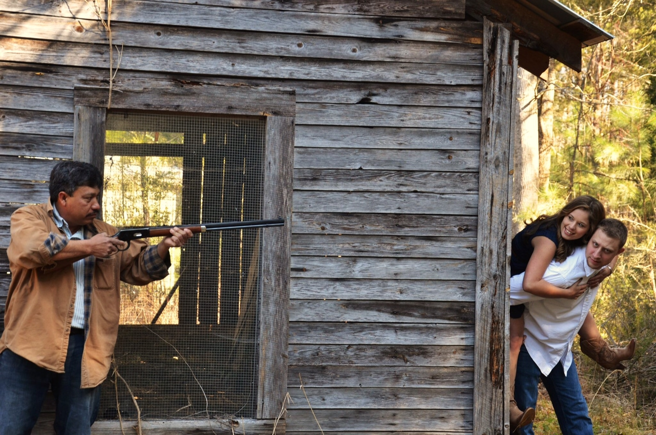 dad pointing gun at husband
