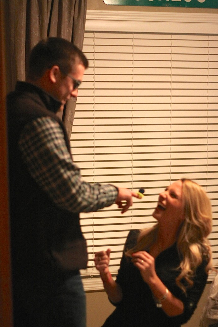 girl asks boyfriend to marry her with ring pop