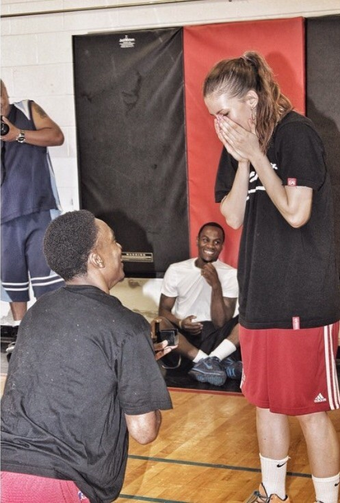 Image 1 of Basketball Player Fakes Injury to Propose to Girlfriend [VIDEO]