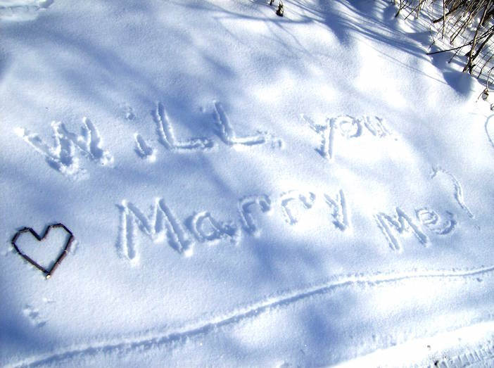 creative marriage proposal idea in snow