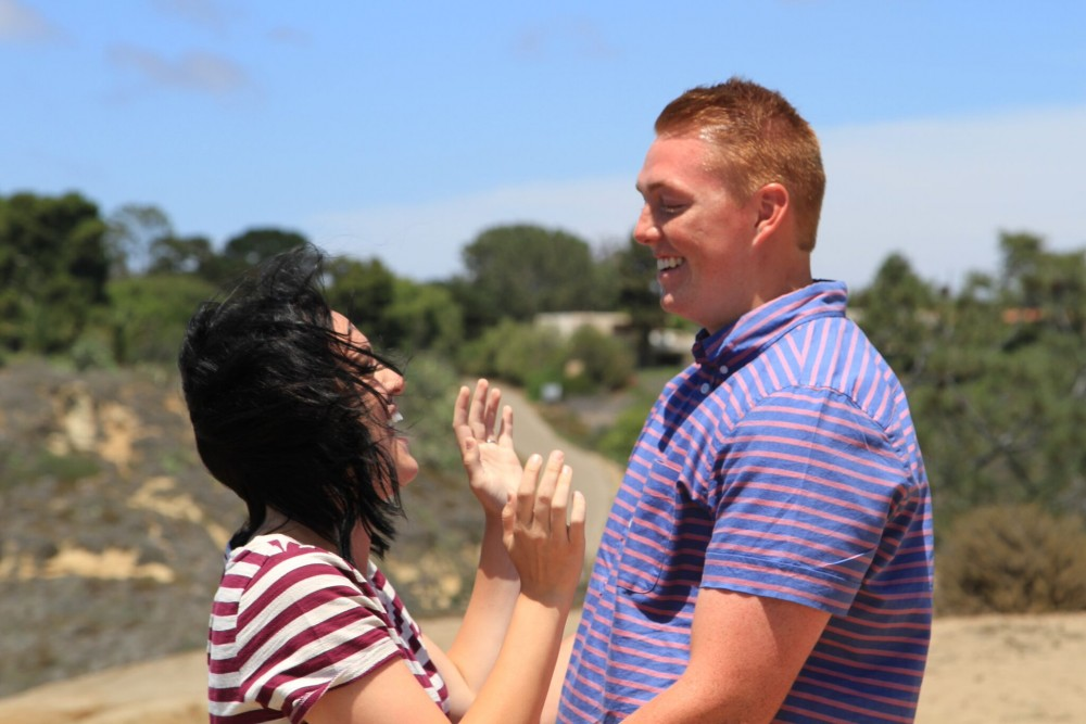 Image 4 of Madison and Tanner's Surprise Proposal at the Beach