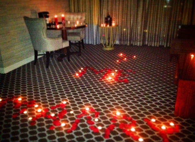 She had him do a scavenger hunt all throughout Las Vegas, and led him to a room at Caesars Palace, which Monique had rose pedals and candles spelling out Marry Me?