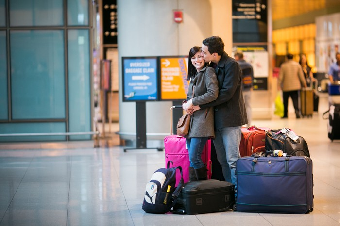 Image 1 of Nicole and James and their Super Sweet Airport Proposal