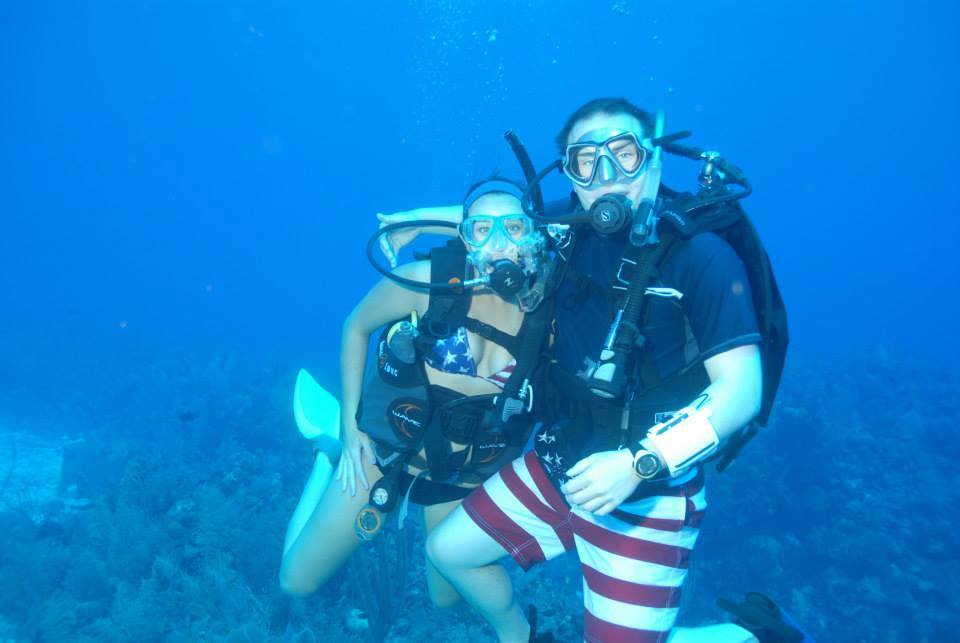 Elliot and I scuba diving together. The accidental matching American flag suits should have been a sign we were a match.