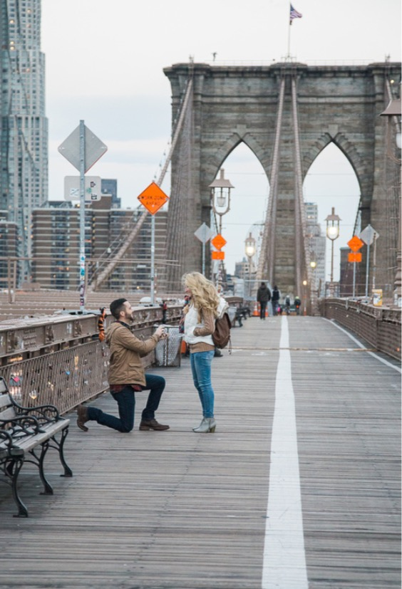 On the 3rd morning of our 8 day vacation to the Big Apple all the way from Tennessee, Matt proposed as the sun was rising on the Brooklyn Bridge and hired a surprise photographer.