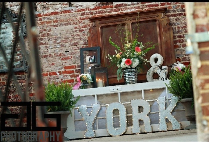 This is the venue that had big light up letters of the grooms last name and he stood in front of this table and proposed.