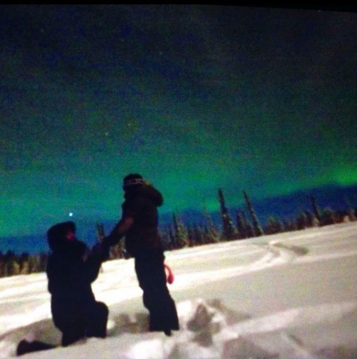 Proposal Ideas In a snow covered field in Fairbanks, Alaska, underneath the Aurora Borialis