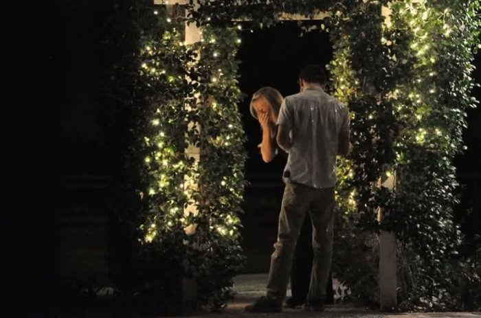 Engagement Proposal Ideas in Where we had first kissed. (under a lit up arch)