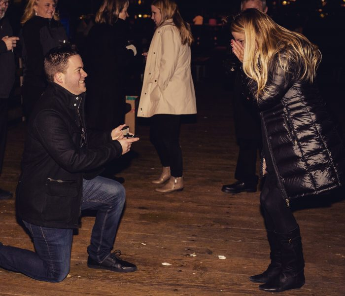 Kelsey and Nathan's Engagement in The pier on Alki Beach in Seattle wa