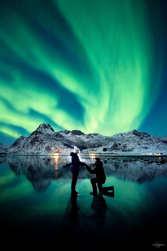 couple near northern lights as romantic place to propose