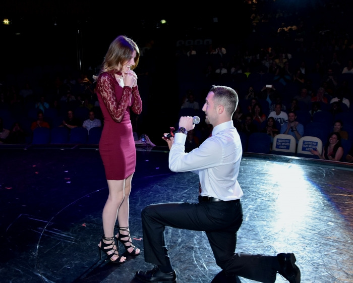 Emily and Zac's Engagement in on stage at the theater on a cruise ship