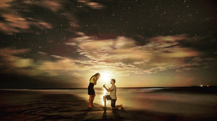 Destiny and Adam's Engagement in During moonrise under the stars at the beach
