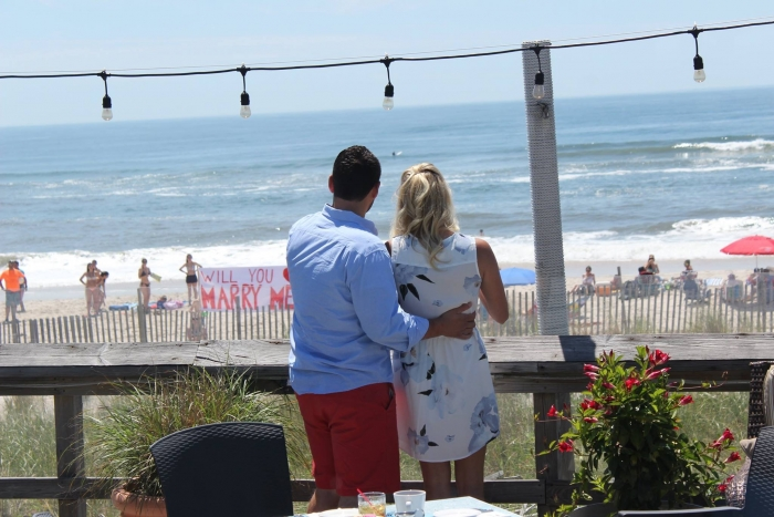Christie's Proposal in At a restaurant overlooking the beaxh