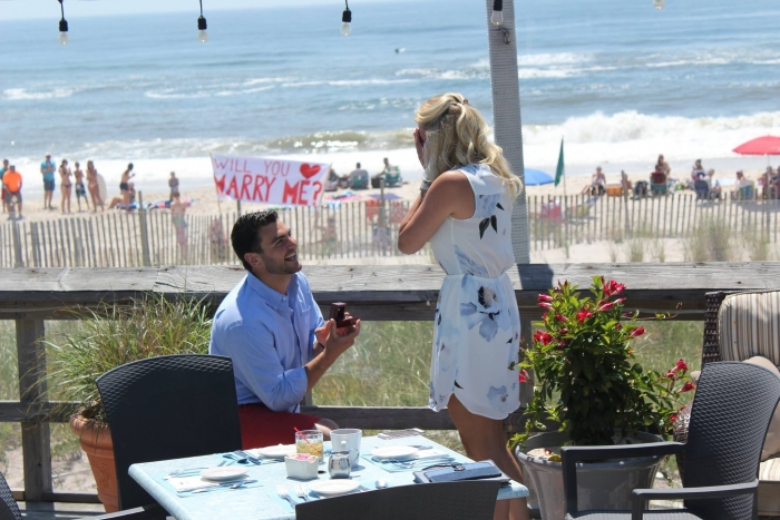 Engagement Proposal Ideas in At a restaurant overlooking the beaxh