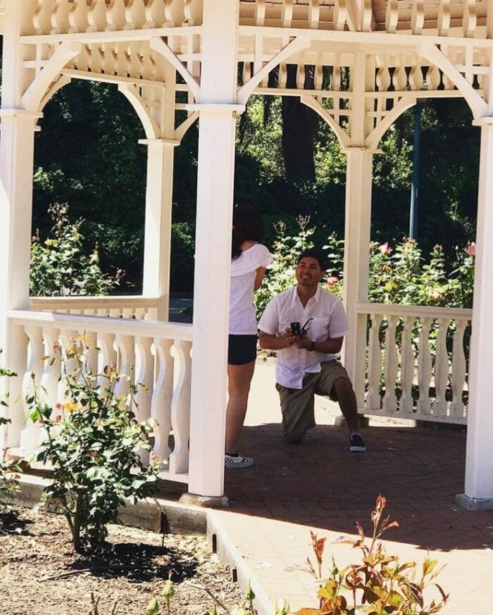 Engagement Proposal Ideas in Inside a gazebo surrounded by roses