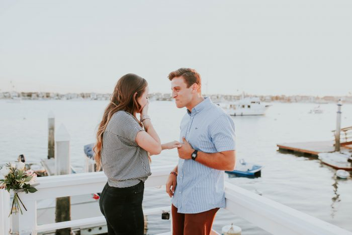 Cassie's Proposal in The end of a dock in Balboa