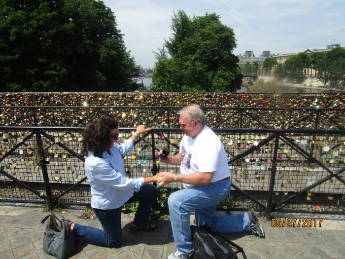 Melinda and Dennis 's Engagement in Paris, at the wall of locks