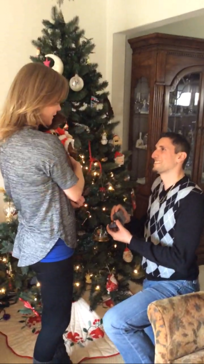 Proposal Ideas In front of Christmas tree at groom's house