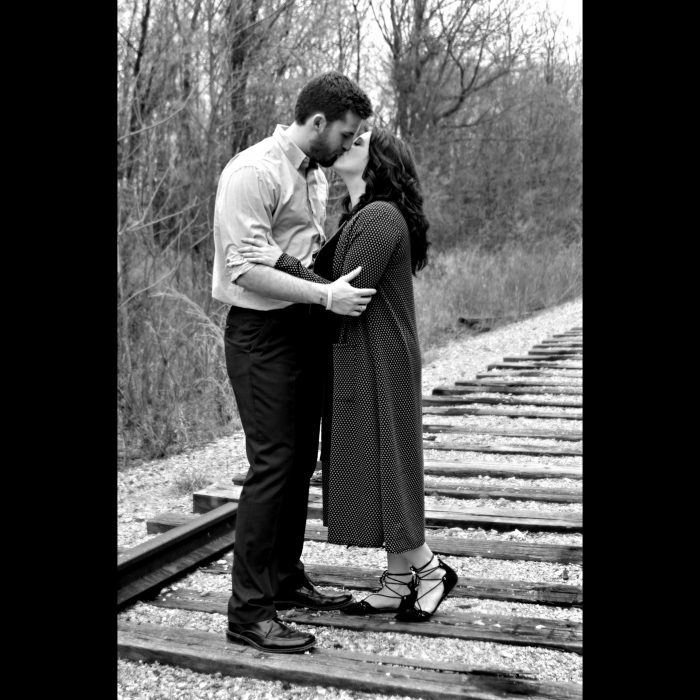 Whitney and Logan's Engagement in On the bridge at the biology pond at MSSU