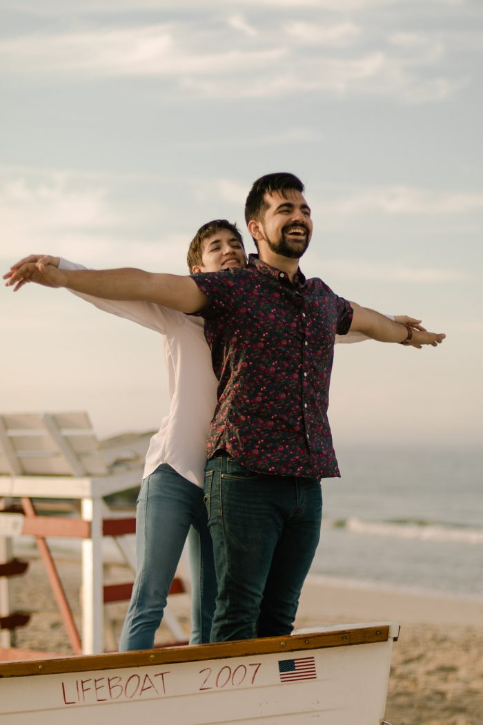 Titanic pose engagement session at the beach