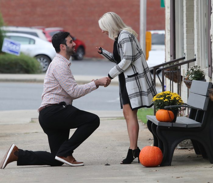Engagement Proposal Ideas in In downtown Mount Pleasant across from a cute restaurant