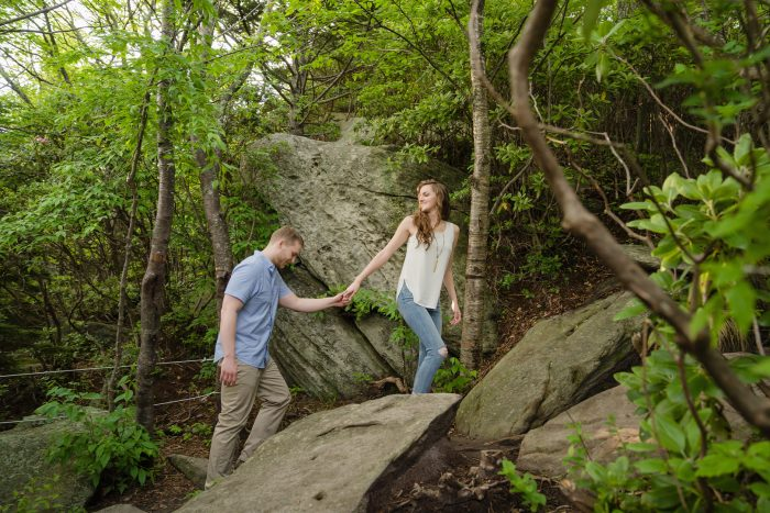 Romantic walk up Grandfather Mountain for couple's engagement session in North Carolina.