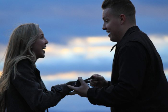 Kaitlyn's Proposal in Groton, MA on a hill with a castle perched atop. Perfect for watching sunsets.
