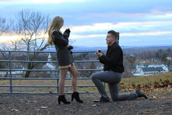 Kaitlyn and Michael's Engagement in Groton, MA on a hill with a castle perched atop. Perfect for watching sunsets.