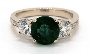 three-stone emerald engagement ring