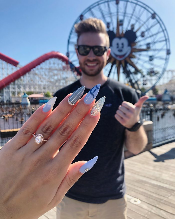 Ryan and Mallory's Engagement in In Disneyland, at California Adventure on Pixar Pier in front of the Ferris wheel.