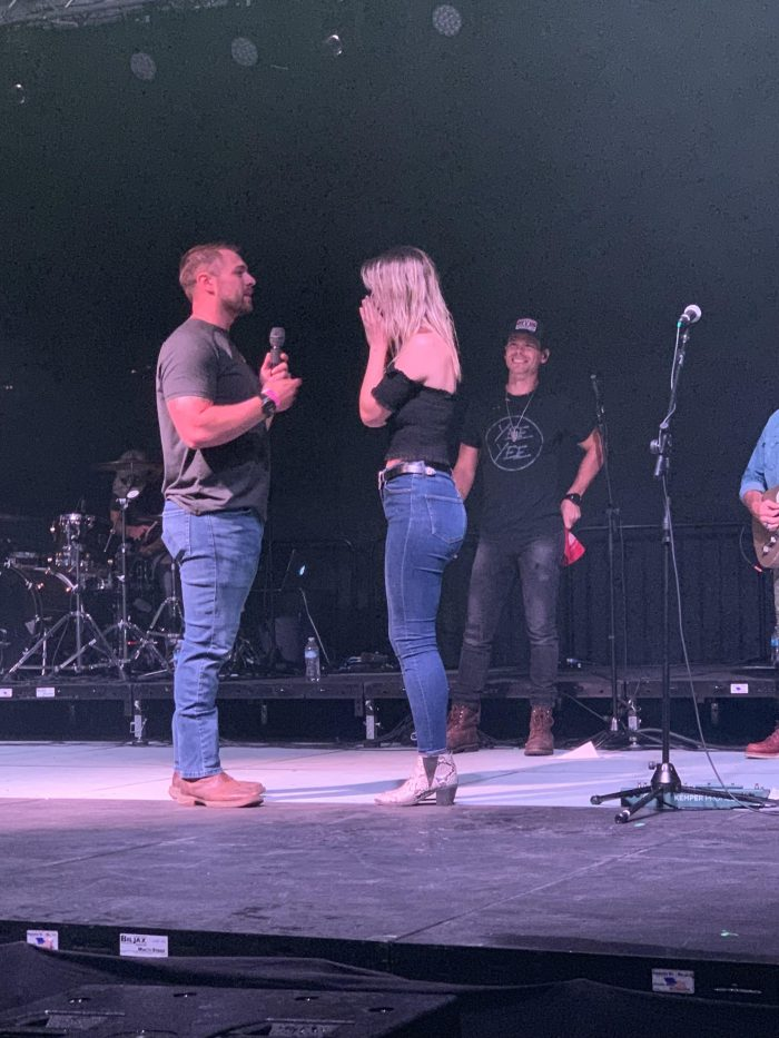 Shelby and Dylen's Engagement in On stage at a Granger Smith concert