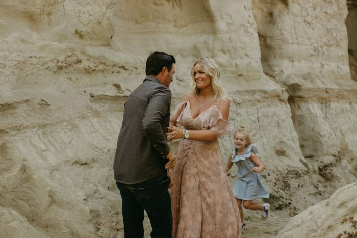 Casandra and Paul's Engagement in San Clemente Beach, but back in the rock caves