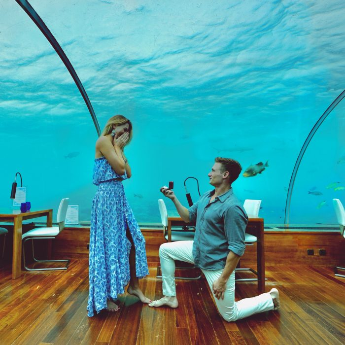 Juliette and Daniil's Engagement in The Maldives in an underwater restaurant called Ithaa