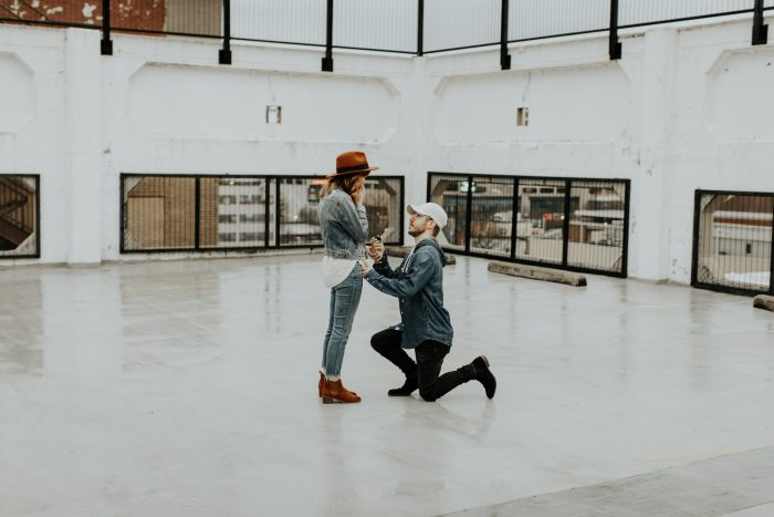 Engagement Proposal Ideas in The top of a parking garage in downtown ATL.